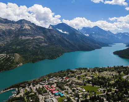 Waterton Lakes National Park - Clear lakes, thundering waterfalls, rainbow-coloured streams, colourful rocks and mountain vistas await hikers and sightseers.