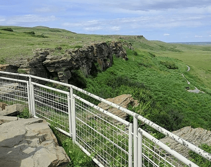 Head-Smashed-In Buffalo Jump - World Heritage Site Where the foothills of the Rocky Mountains meet the Great Plains sits one of the world's largest, oldest, and best-preserved buffalo jumps.